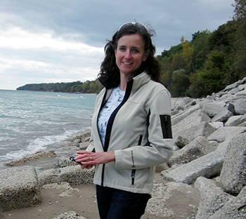 Karen Sands standing on a rocky beach